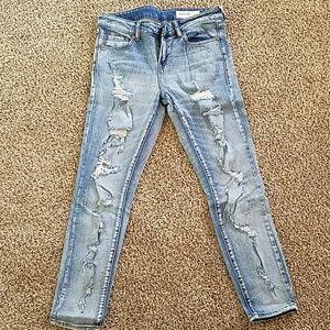Holey light wash skinny jeans